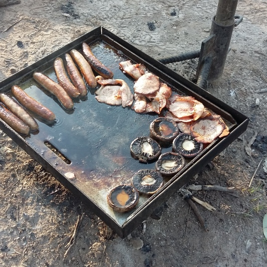 Breakfast cooked over camp fire